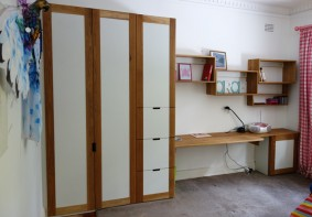 Custom made wardrobe and work station, American oak and rhino ply.