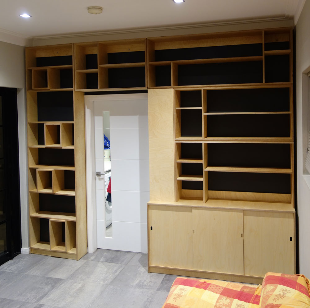 Cusom wall unit, shelves and cabinet in Birch Plywood