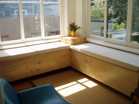 Window seats/storage chests roll and clip together to form double bed, plywood with satin clear finish