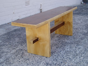 Bench in plywood with walnut stained top and satin clear finish