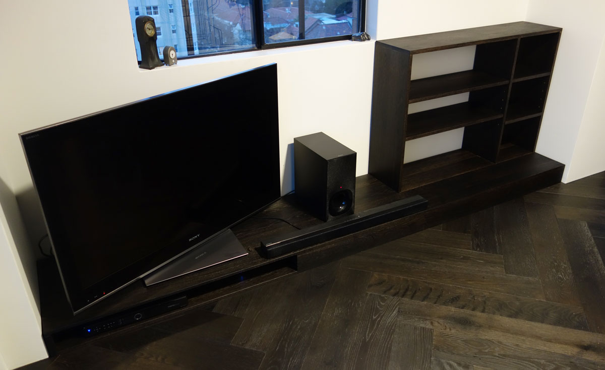 custom made low-rise entertainment unit in ebonised American oak