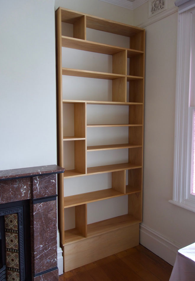 Kauri pine bookshelves custom made forfireplace recess