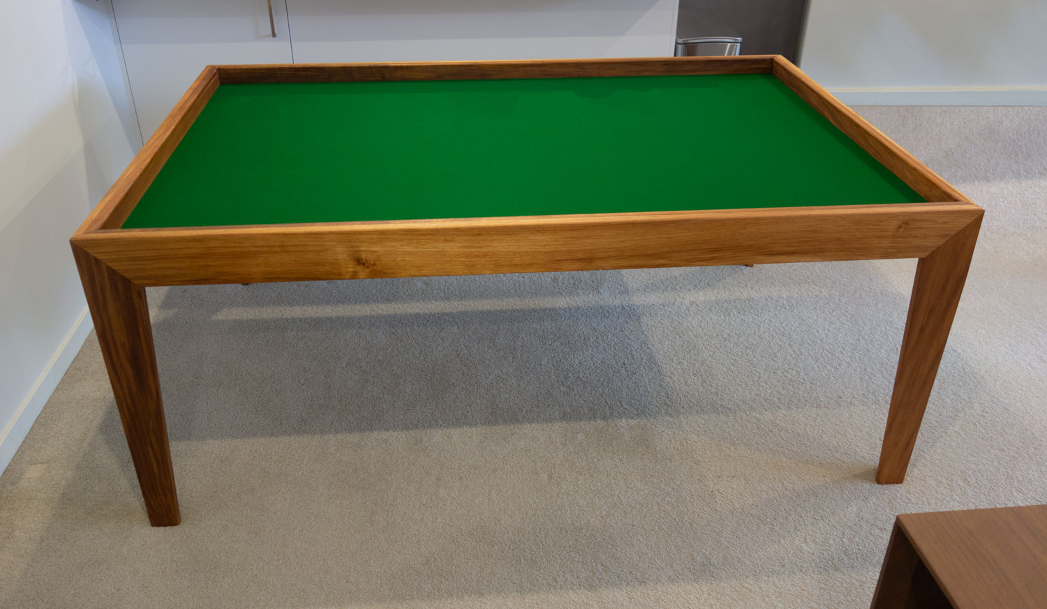 Dining table with top removed becomes a games table